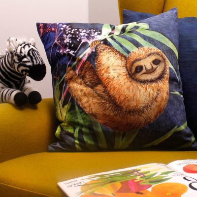 Relaxing Sloth | Brown & Blue Sofa Cushion Tropical Interior